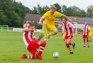 Max Dickov rides tackle of Cheadle Town player