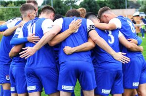 Squires Gate players huddle before kick off